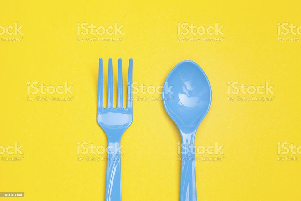 plastic spoon isolated on yellow background royalty-free stock photo