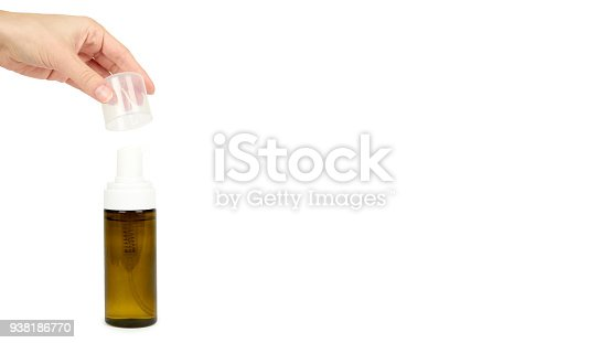 istock Plastic spray bottle with pump in hand isolated on white background. Foam dispenser for face care. Container with body lotion. copy space, template. 938186770