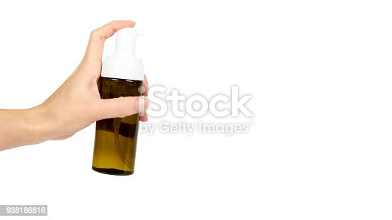 istock Plastic spray bottle with pump in hand isolated on white background. Foam dispenser for face care. Container with body lotion. copy space, template. 938186816