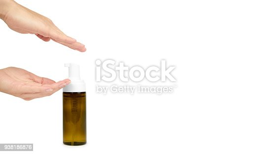 istock Plastic spray bottle with pump in hand isolated on white background. Foam dispenser for face care. Container with body lotion. copy space, template. 938186876