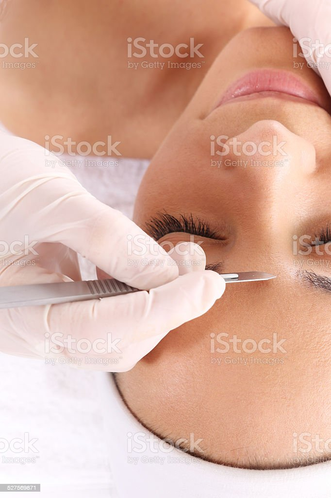 Plastic surgery, a woman in the clinic of aesthetic surgery stock photo