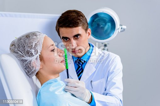 istock Plastic surgery doctor, patient inspection and consultation 1130550418