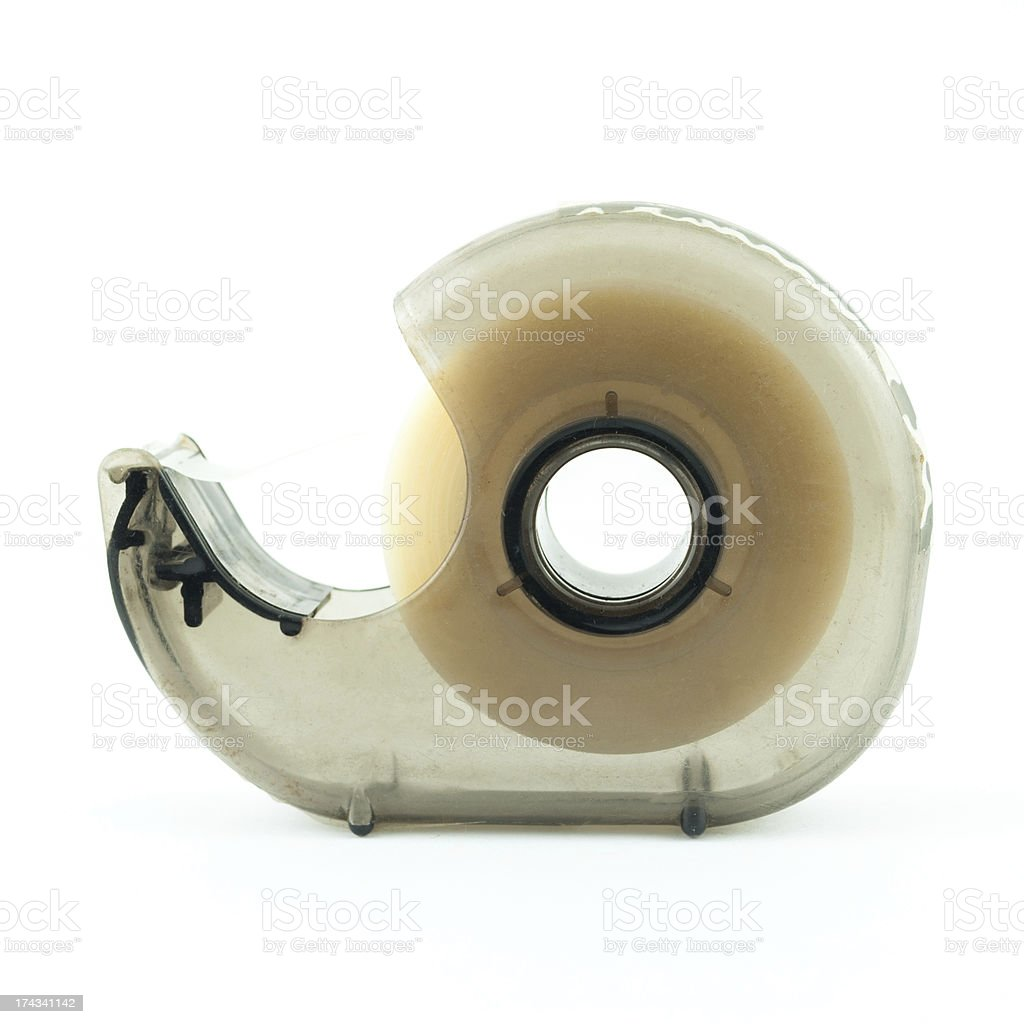 Plastic tape holder in front of a white background royalty-free stock photo