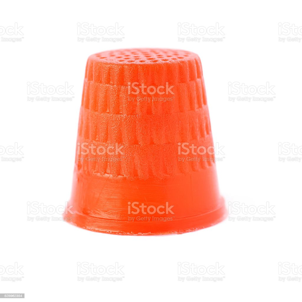 Plastic thimble isolated over the white background stock photo