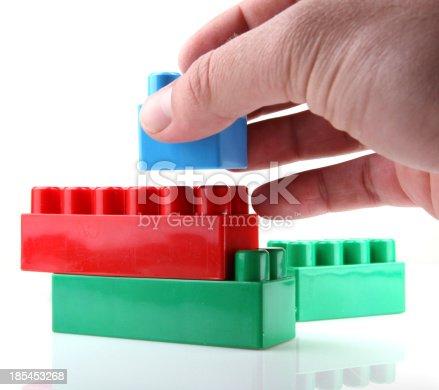 865870702 istock photo Plastic Toy Blocks On White Background 185453268