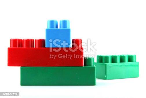 865870702 istock photo Plastic Toy Blocks On White Background 185453281