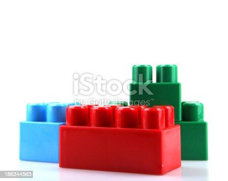 865870702 istock photo Plastic Toy Blocks On White Background 186344563