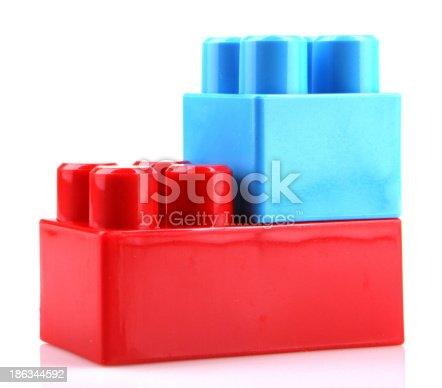 865870702 istock photo Plastic Toy Blocks On White Background 186344592