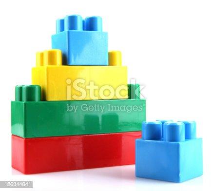 865870702 istock photo Plastic Toy Blocks On White Background 186344641