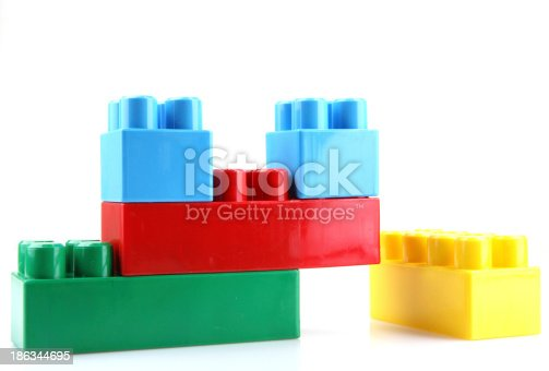 865870702 istock photo Plastic Toy Blocks On White Background 186344695