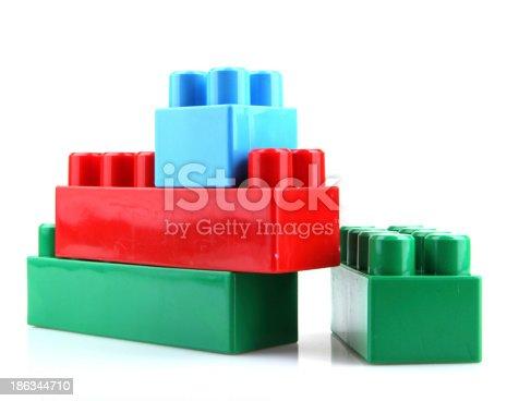 865870702 istock photo Plastic Toy Blocks On White Background 186344710