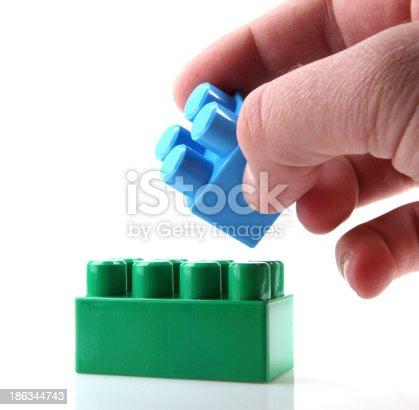 865870702 istock photo Plastic Toy Blocks On White Background 186344743