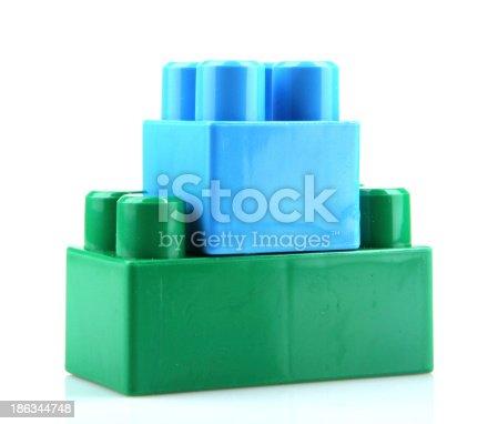 865870702 istock photo Plastic Toy Blocks On White Background 186344748