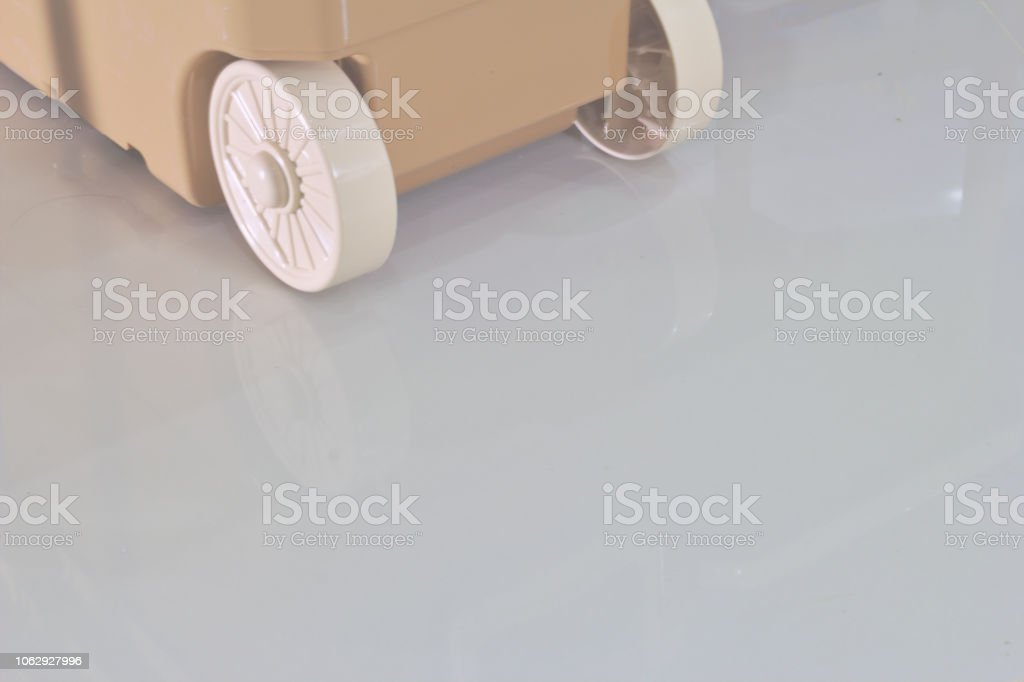 Plastic Toy Box with Baby Wheel in Background stock photo