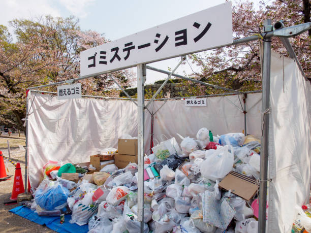 Plastic trash bags at a park garbage bin, Himeji, Japan stock photo