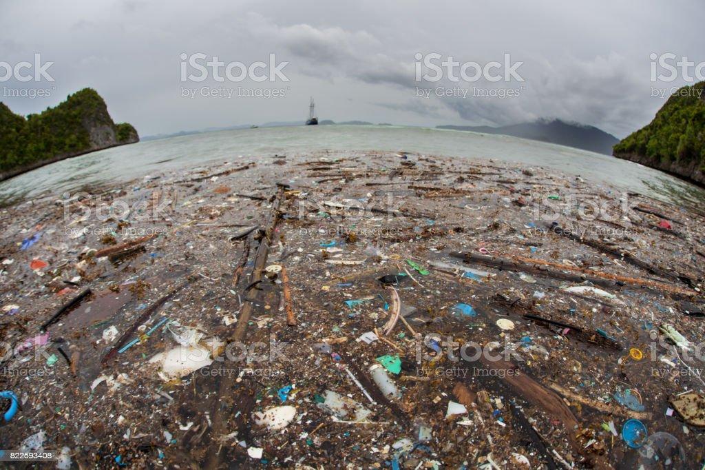 Plastic Trash in Tropical Pacific Ocean stock photo