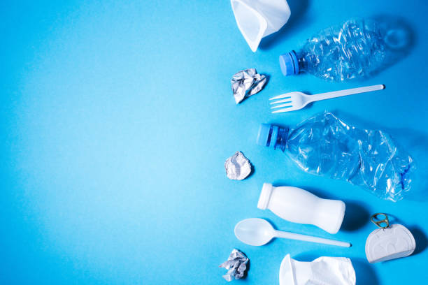Plastic trash on blue background, Plastic trash on blue background, eco concept image with copy space. disposable stock pictures, royalty-free photos & images