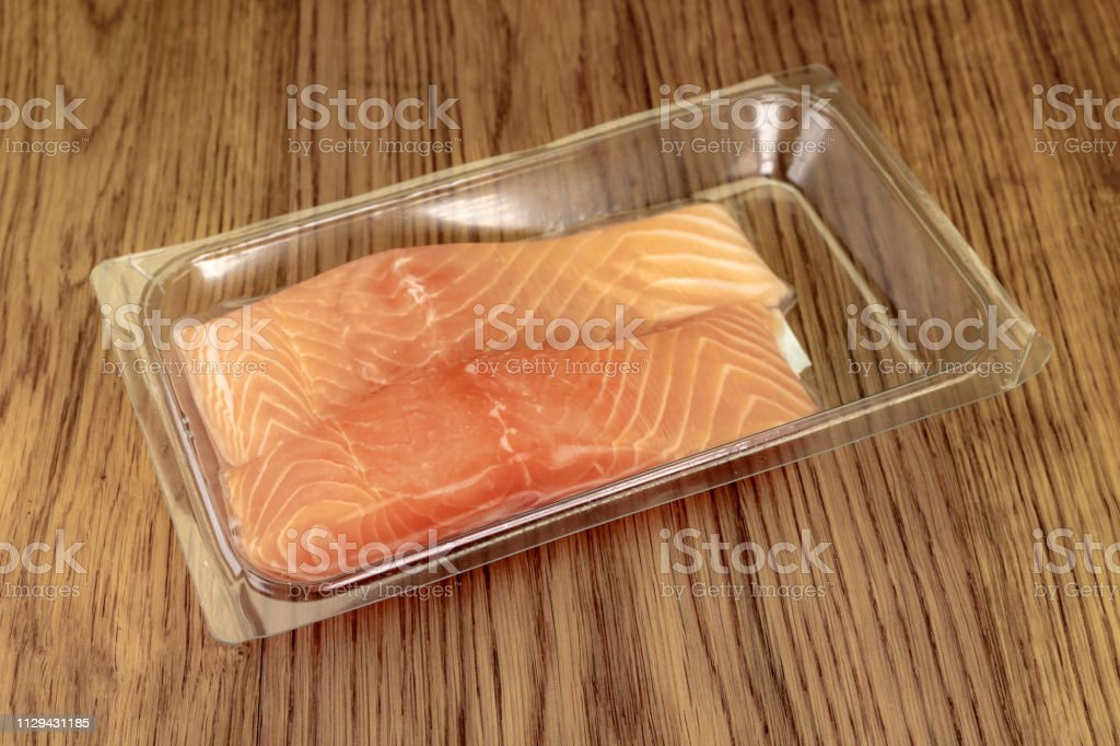 Plastic vacuum packed salmon fish fillets stock photo