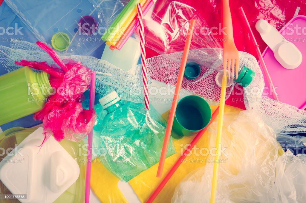 Plastic waste background Various colorful plastic products Backgrounds Stock Photo