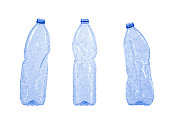 Three empty plastic waste bottles isolated on white background, clipping-path included