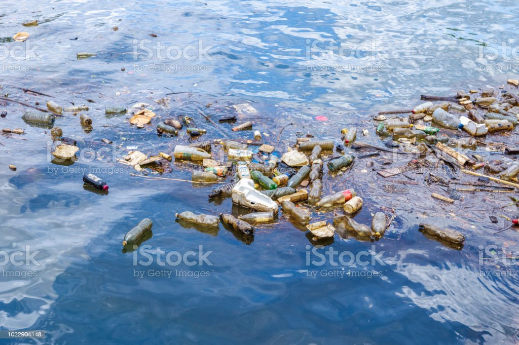 Plastic waste floating in the ocean stock photo