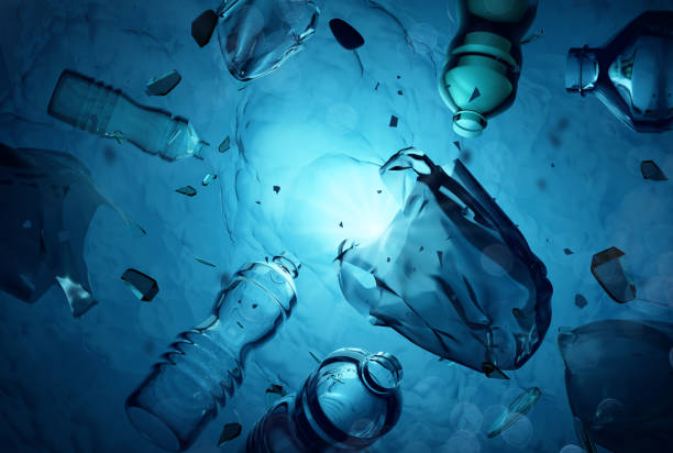Plastic Waste Floating In The Open Ocean stock photo