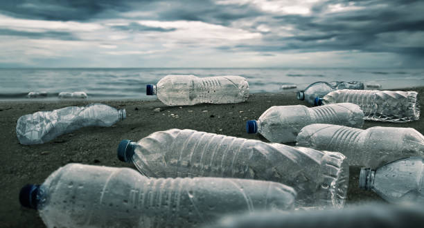 plastic water bottles pollution in ocean (environment concept) - plastic stock pictures, royalty-free photos & images