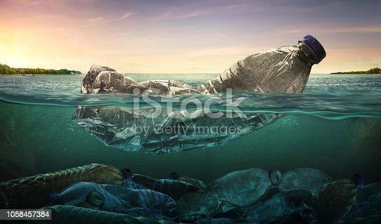 istock Plastic water bottles pollution in ocean (Environment concept) 1058457384