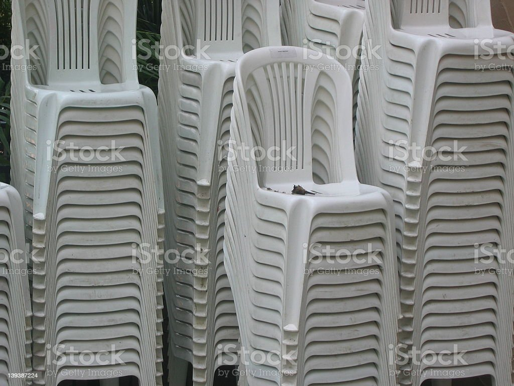 Plastic White Stacked Chairs royalty-free stock photo