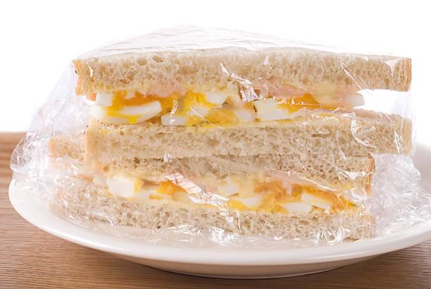 Plastic Wrapped Sandwich bildbanksfoto