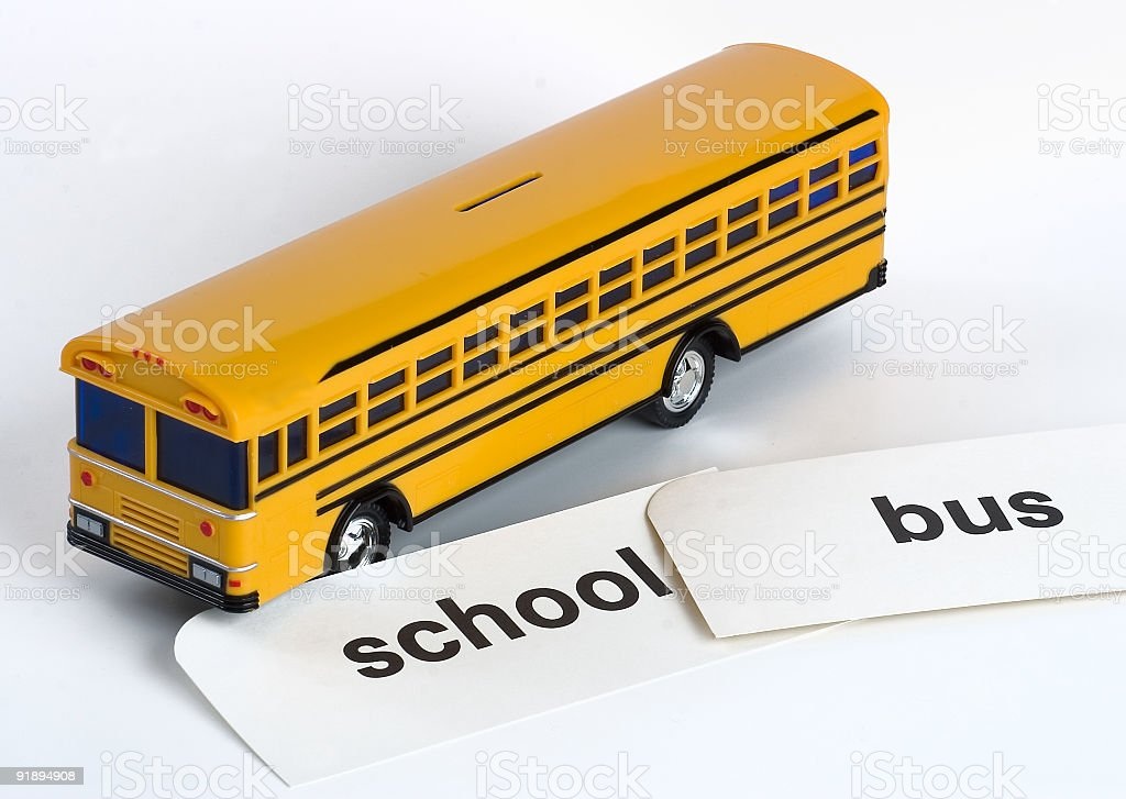 Plastic Yellow Toy School Bus Bank with Flash Cards royalty-free stock photo
