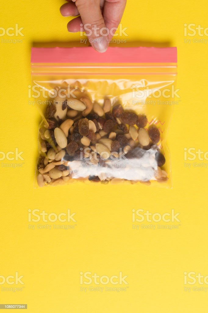 Plastic zip package for food storage. Healthy snack nuts in a closed...