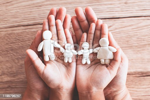 Plasticine clay happy family on child and parent hands. Happy family and love concept.
