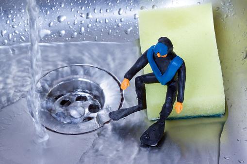 plasticine diver sitting in the kitchen sink