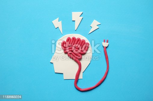 585087100 istock photo Plasticine head and brain inside. Mental activity, psychology concept 1133563224