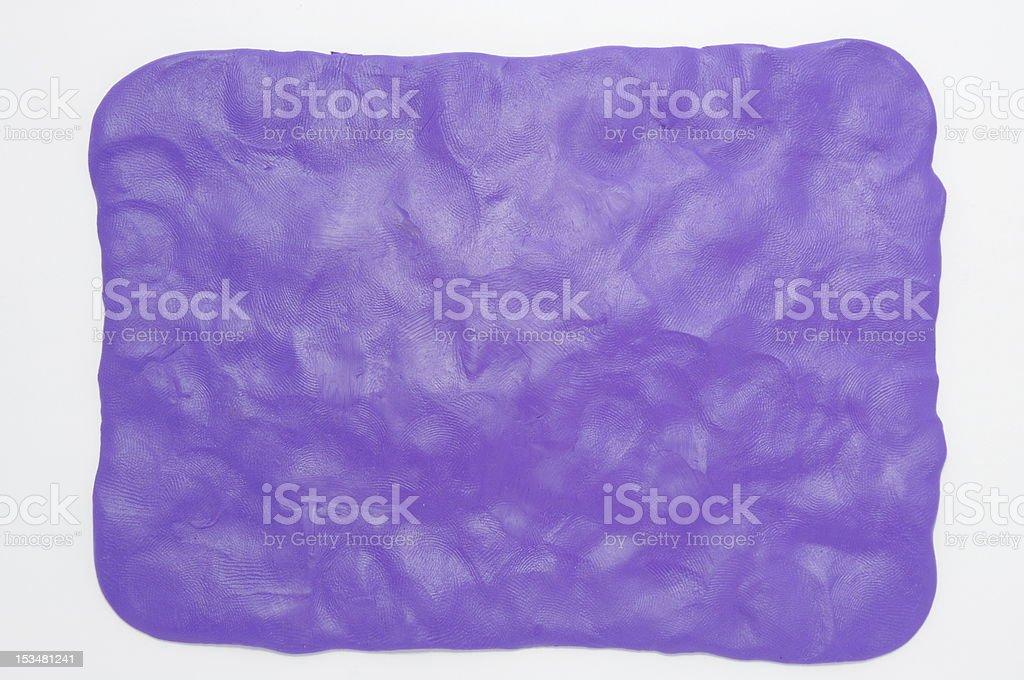 Plasticine fondo púrpura - foto de stock