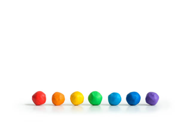 plasticine rainbow. balls of clay on the table in a line isolated on white plasticine rainbow. balls of clay on the table in a line isolated on white clay stock pictures, royalty-free photos & images