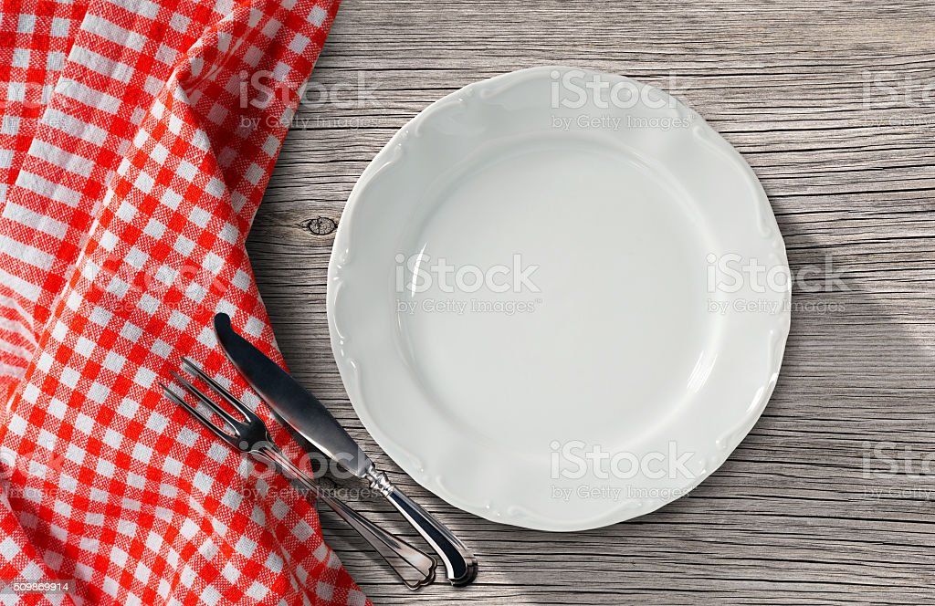Plate and Cutlery on a Table with Tablecloth stock photo