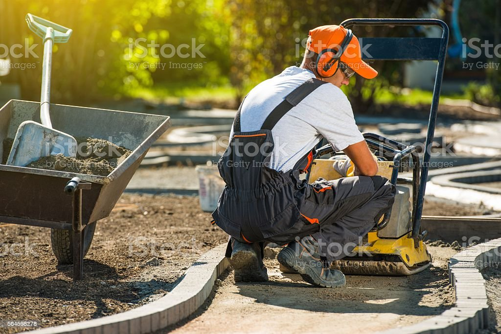 Plate Compactor Brick Works stock photo