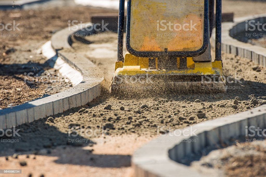 Plate Compactor in Action stock photo