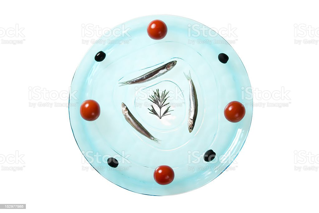 plate decorated with anchovies, tomatoes and olives royalty-free stock photo