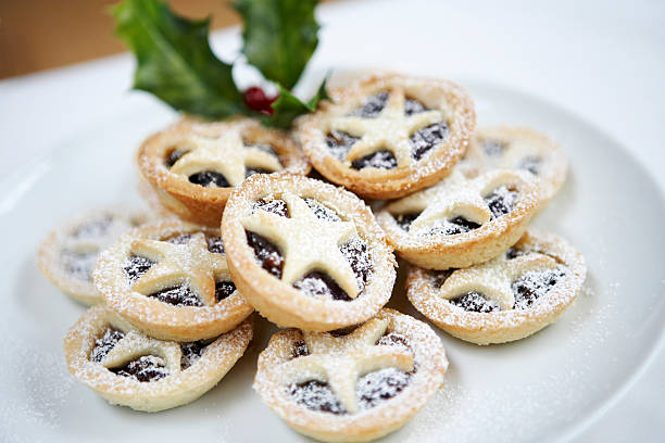 A plate filled with Christmas mince pies stock photo