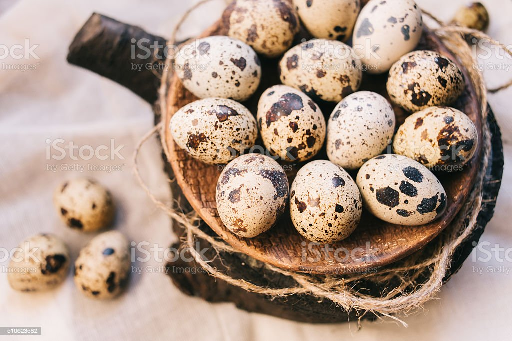 Plate filled with eggs of quails stock photo