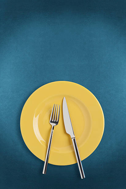 plate, fork and table knife - blue table setting stock photos and pictures