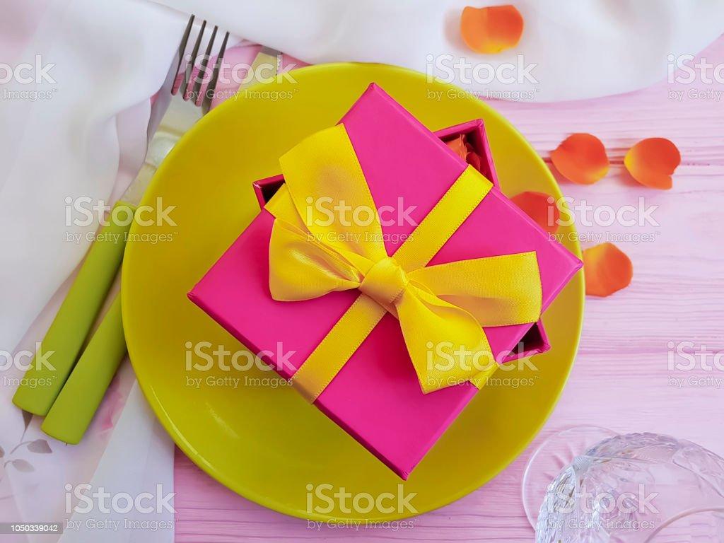 plate fork knife gift box flower rose on wooden