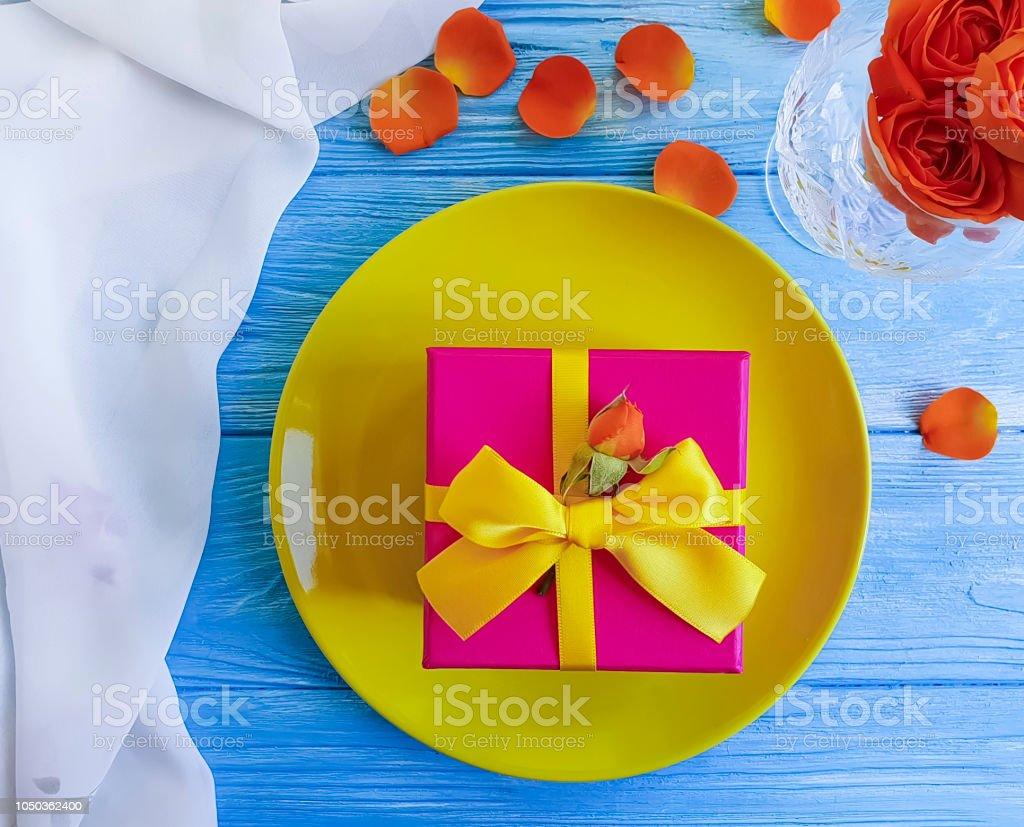 plate, fork, knife gift box flower rose on wooden