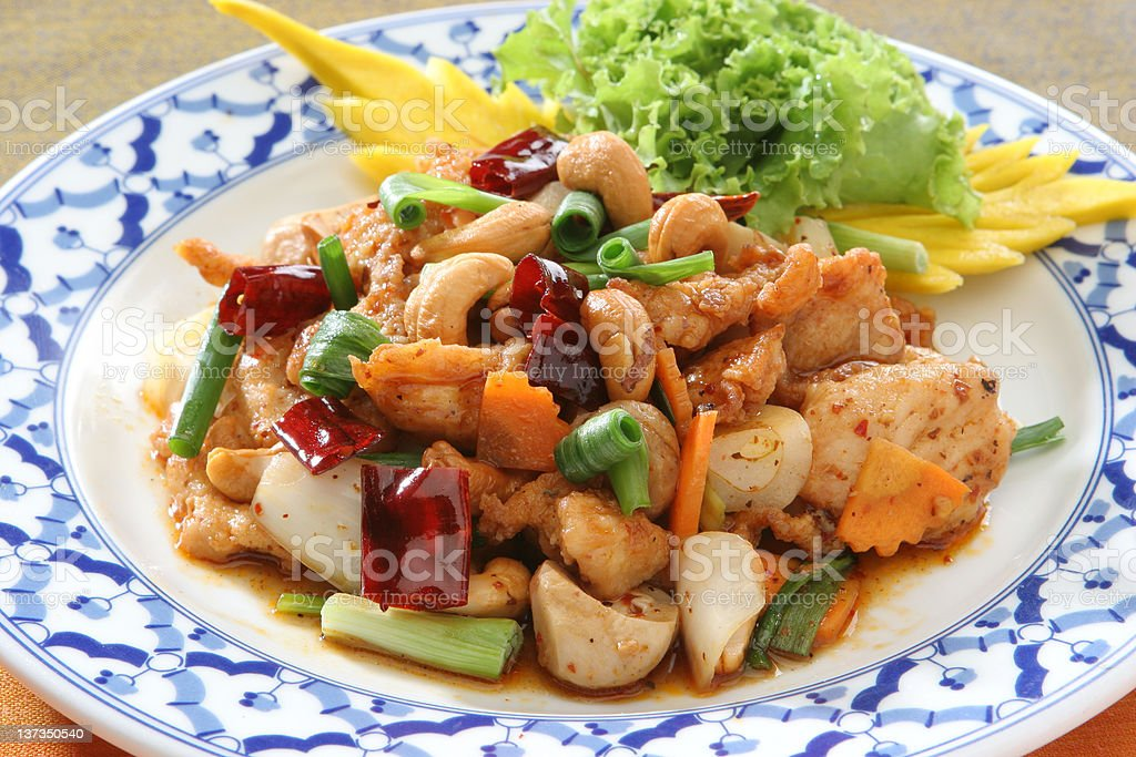Plate full of chicken with cashew nuts and vegetables royalty-free stock photo