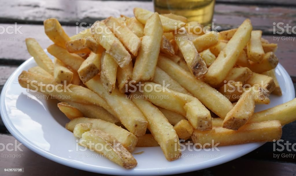 Plate full of French fries stock photo