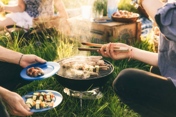 plate full of grilled food,  barbecue with friends - barbecue grill stock photos and pictures
