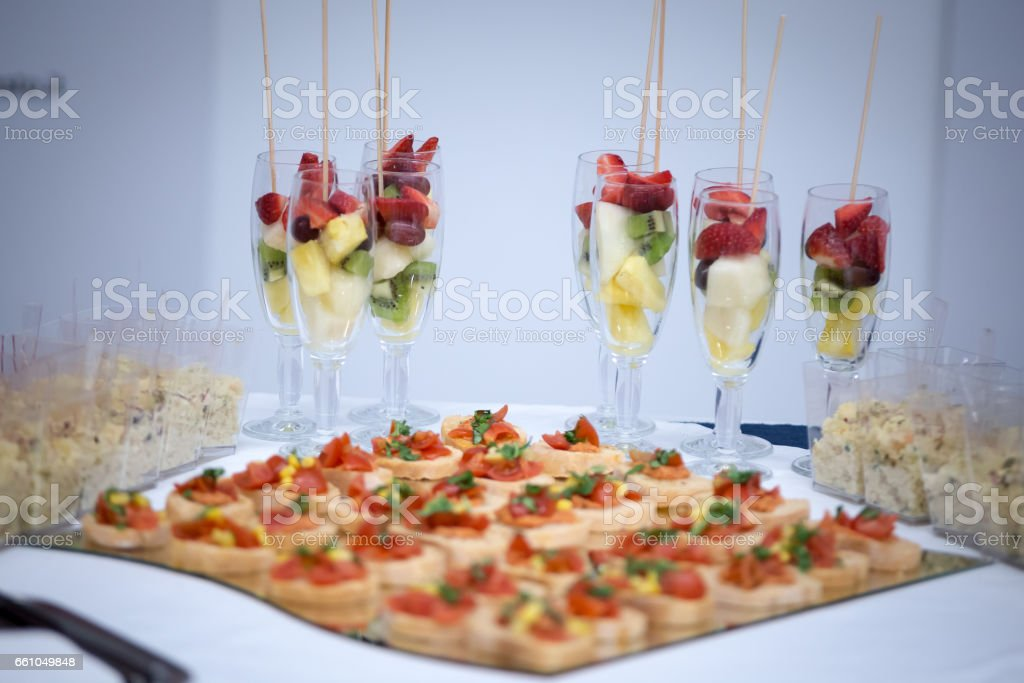 A plate full of little snack anda glasses of fruit stock photo